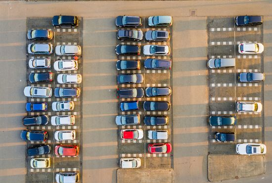 Parking lot with parked vehicles and empty places